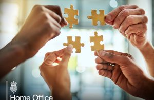 Cropped shot of a group of businesspeople completing a puzzle together in a modern office